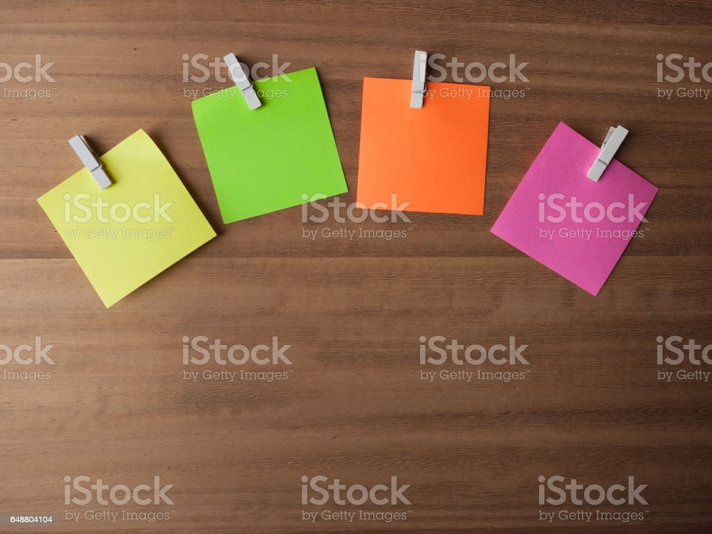 Post It Notes on Pegs On Light Wood stock photo