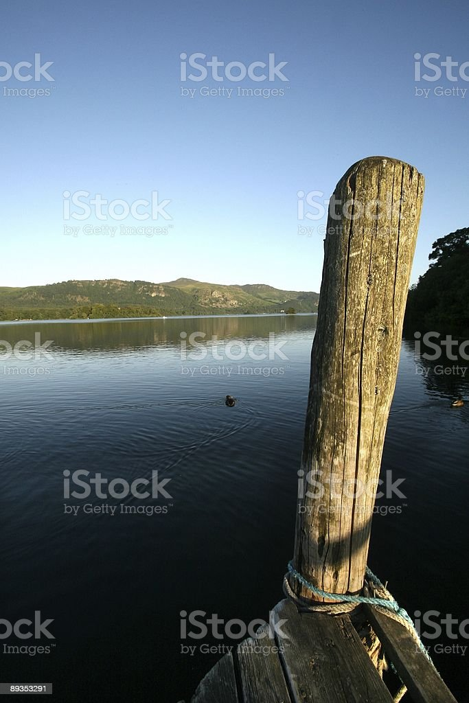Post over tranquil lake royalty-free stock photo