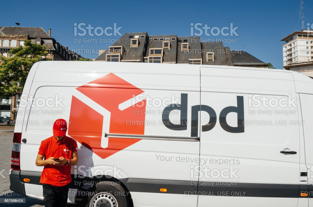 DPD post parcel van delivery with worker stock photo