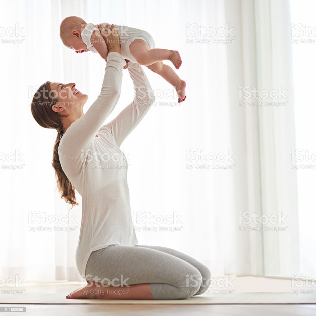 Post pregnancy workout with my little one stock photo