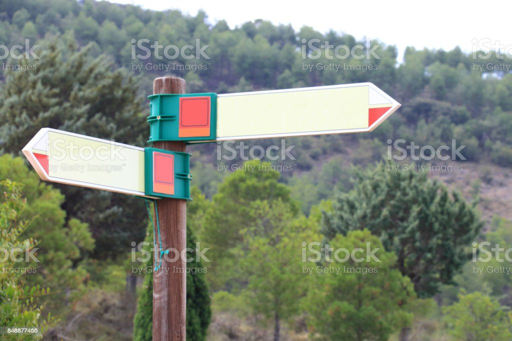 Post with blank directions stock photo
