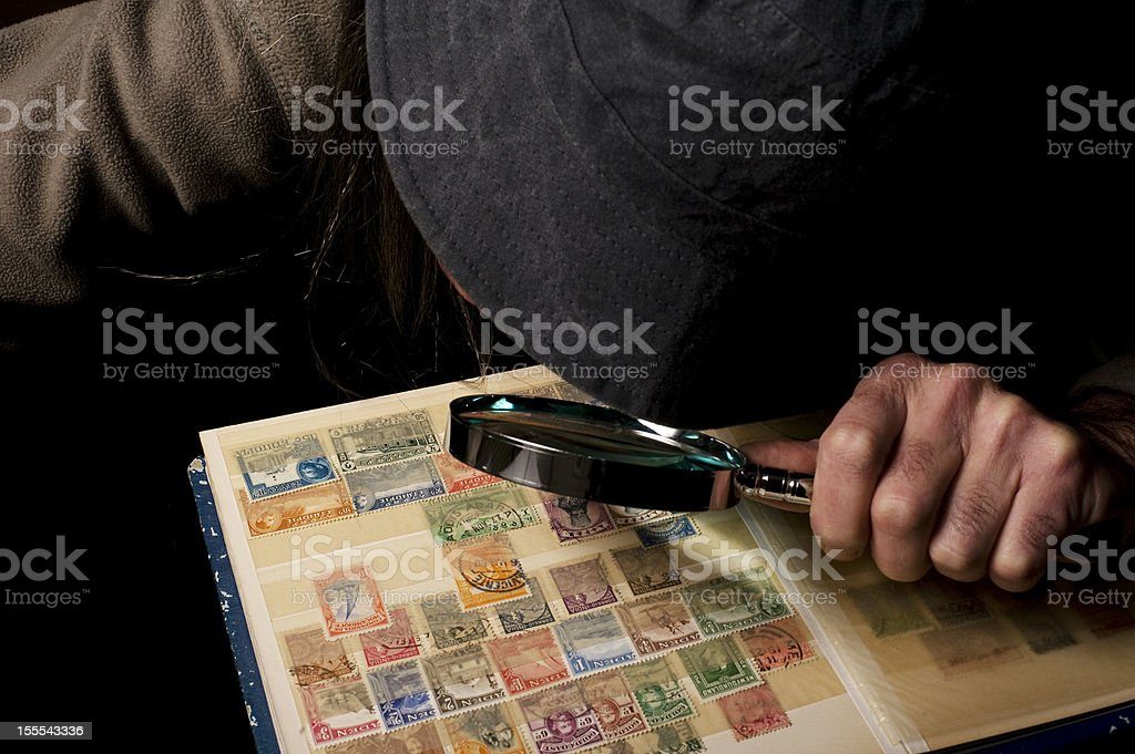 Postage stamp maniac stock photo