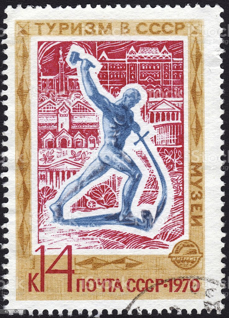 Postage stamp showing sculpture of man with hammer and sword stock photo