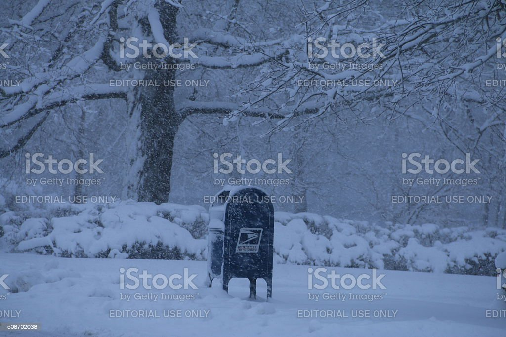 Postal Mailbox in snowstorm stock photo