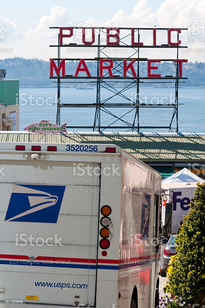 US postal service and FedEx delivery vehicles stock photo