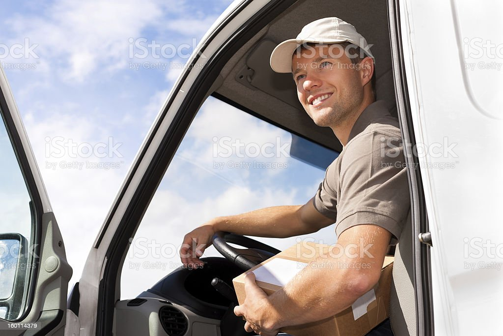 Postal service - delivery of a package royalty-free stock photo
