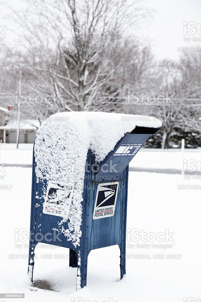 US Postal Service Mail Box Covered With Snow stock photo