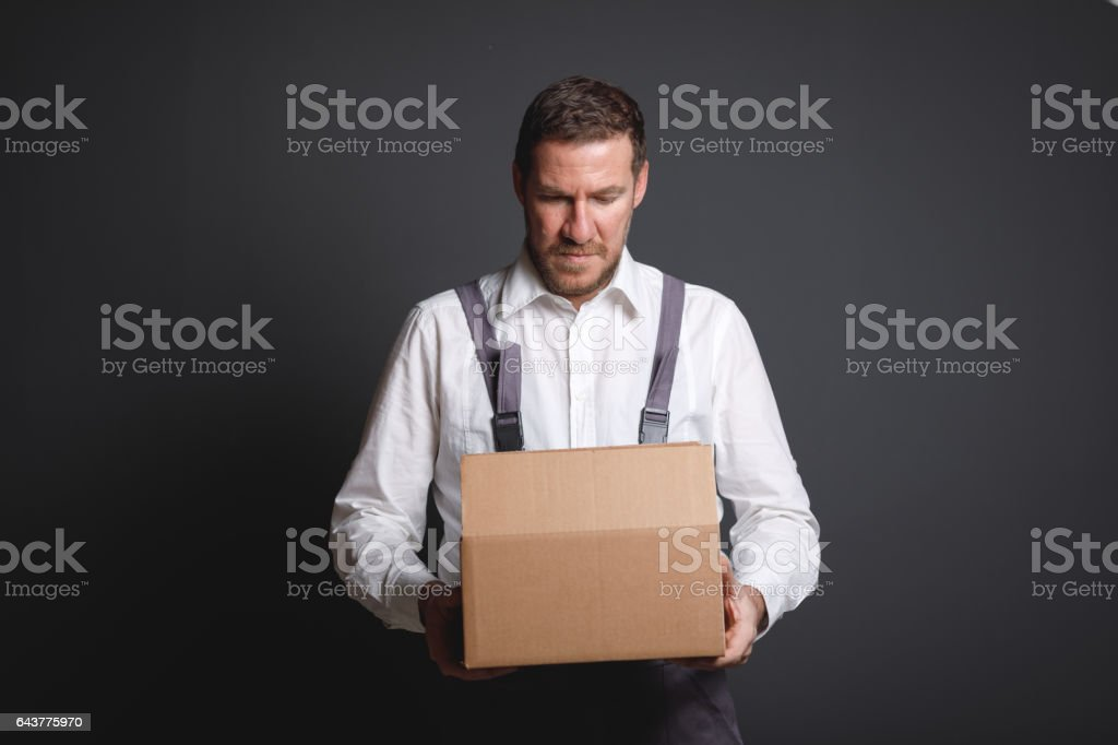 Postal worker with gray background stock photo