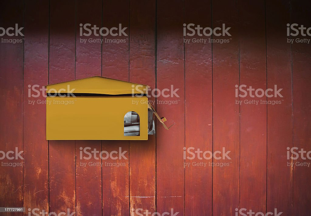 Postbox on wood wall royalty-free stock photo