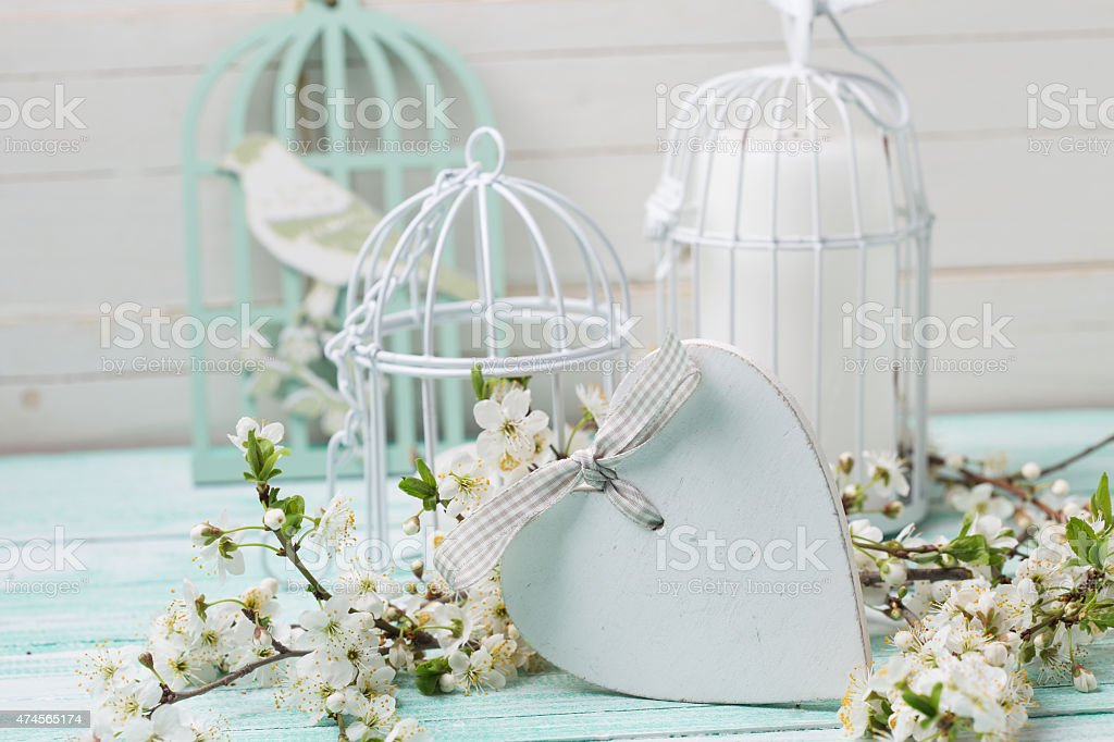 Postcard with flowering tree branches, heart and decorative bird stock photo