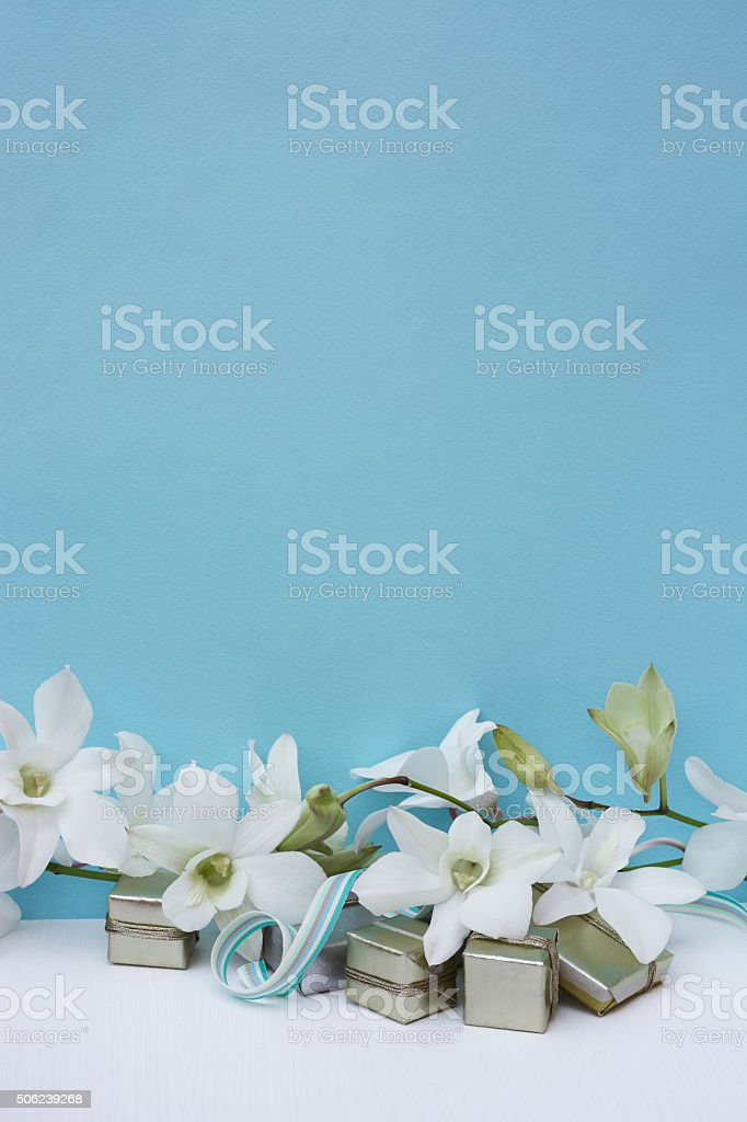 Postcard with white orchids and gifts. stock photo