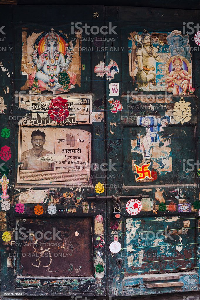 Posters, Announcements  And Advertisement On Old Door In Varanasi stock photo