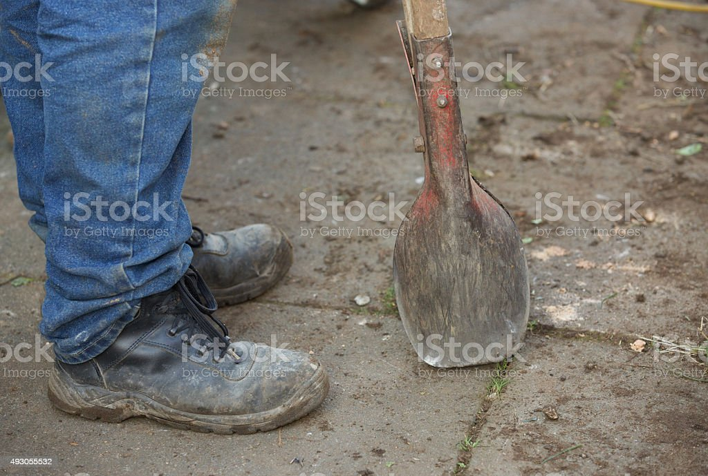 Posthole digger used for digging holes for fencing posts stock photo