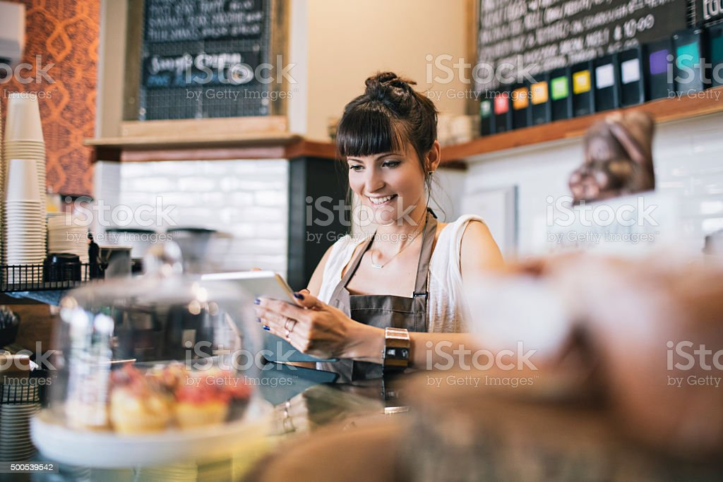 Posting the new cafeteria breakfast deals on the social media stock photo