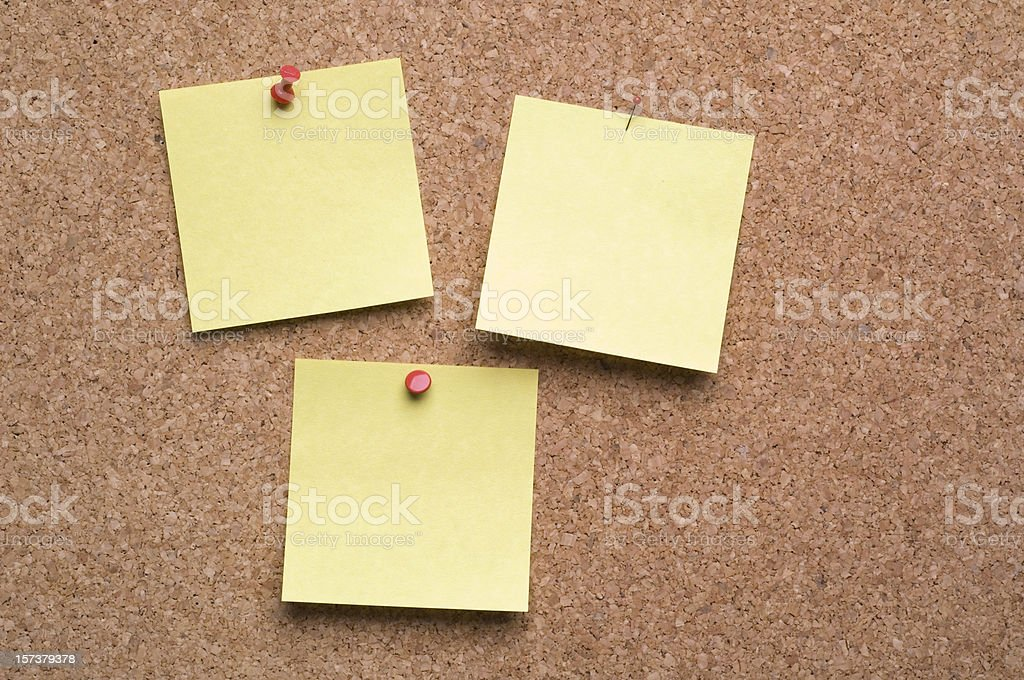 3 Post-it Notes on cork royalty-free stock photo