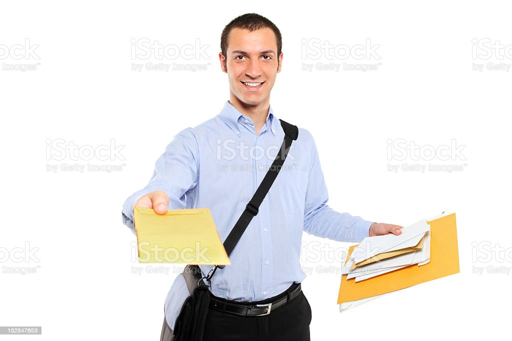 Postman delivering white and yellow envelops of mail stock photo