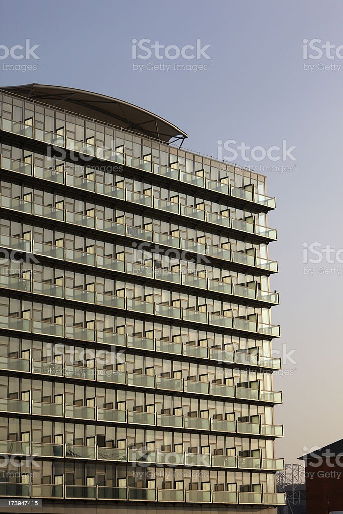 Postmodern Glass Apartment Block with clear evening sky royalty-free stock photo