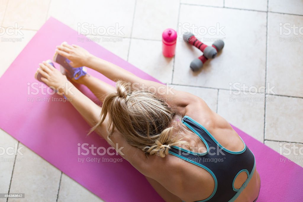 Post-Workout stretches at home stock photo