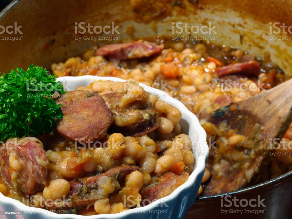A pot and bowl of a hearty cassoulet royalty-free stock photo