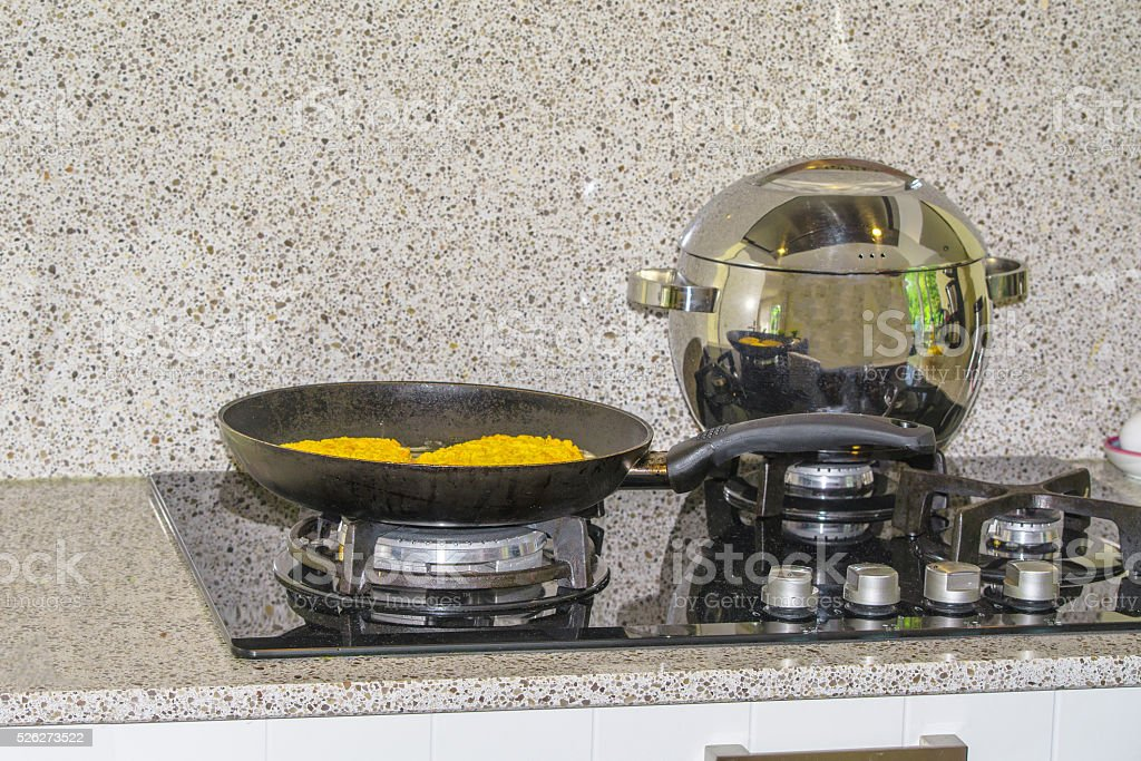 Pot and pan on a gas cooker stock photo