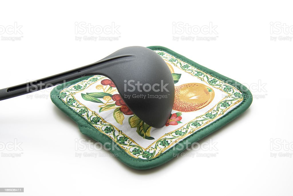 Pot holders with soup spoon royalty-free stock photo
