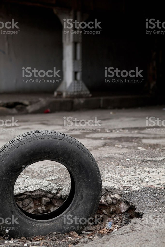 Pot Hole and Tire royalty-free stock photo