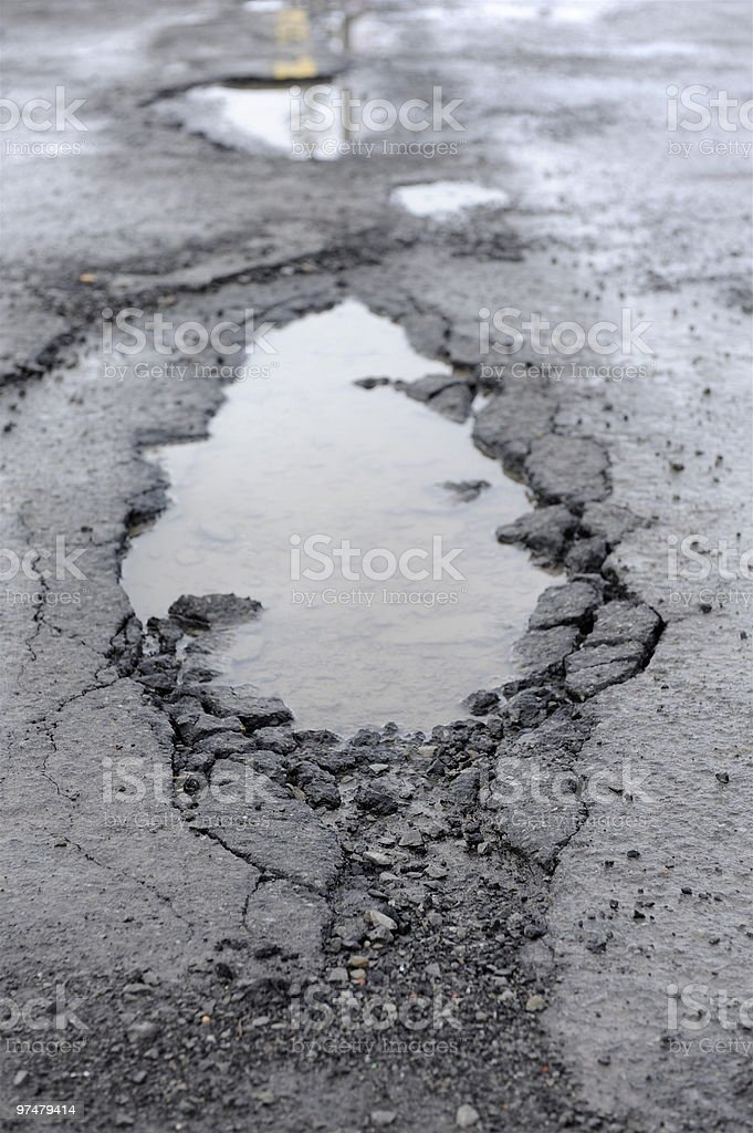 Pot hole full of water royalty-free stock photo