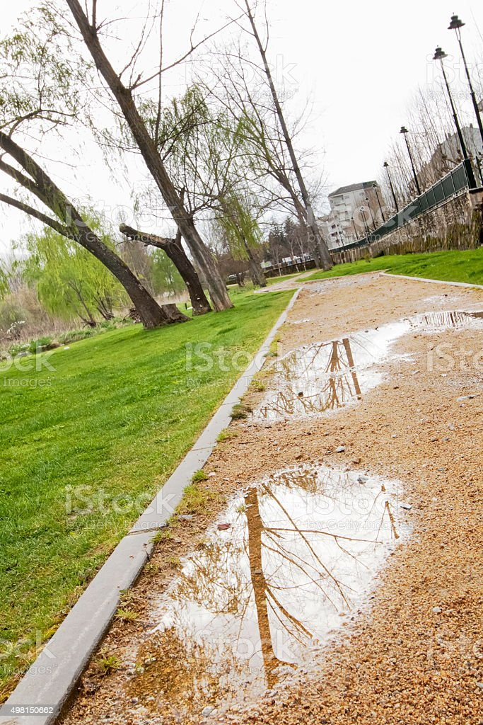 Pot hole in a garden footpath in bad condition. stock photo