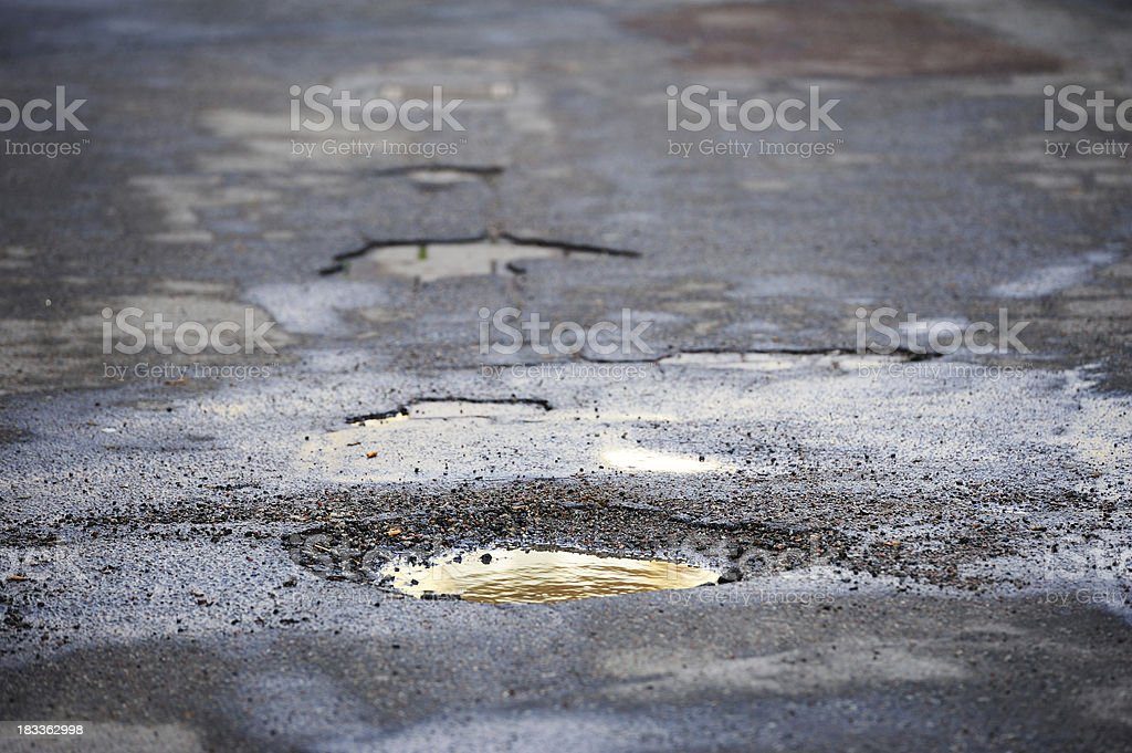 Pot hole on asphalt road stock photo