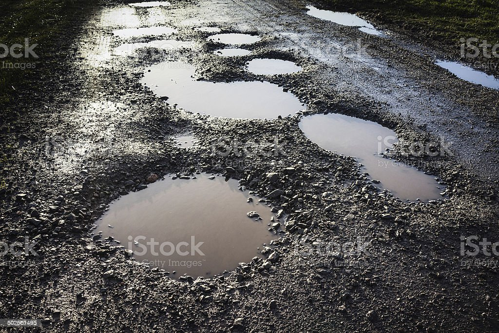 Pot holed road stock photo