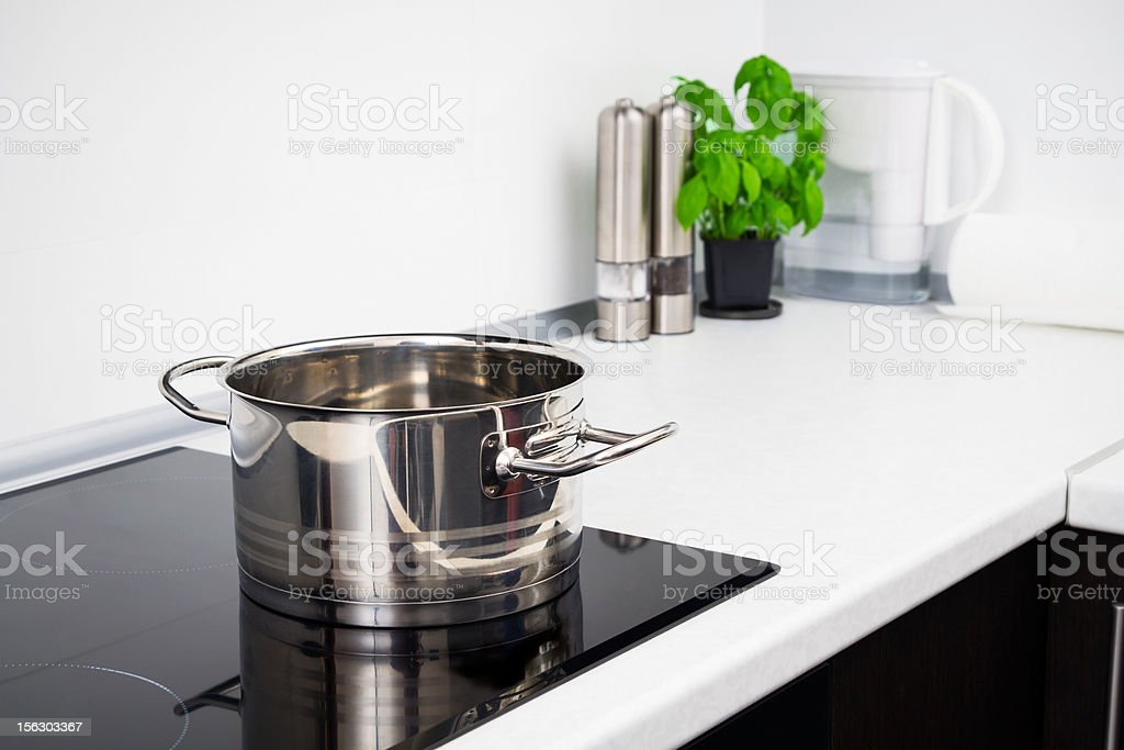 Pot in modern kitchen with induction stove stock photo