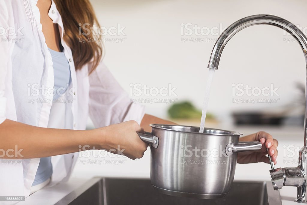 Pot is filled with water stock photo