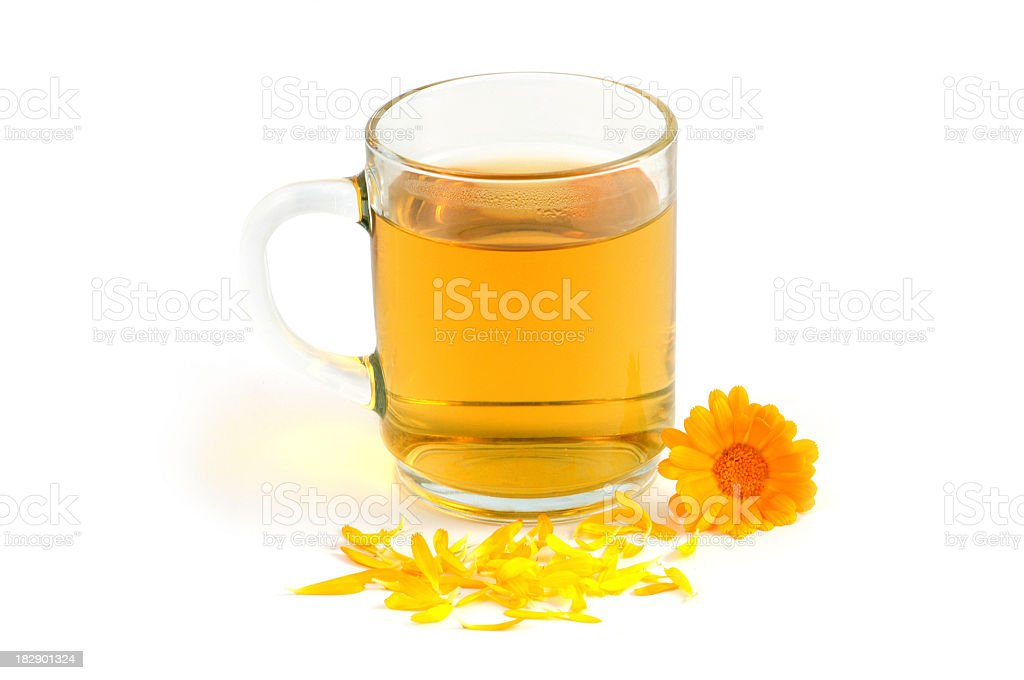 Pot Marigold tea and two flowers royalty-free stock photo