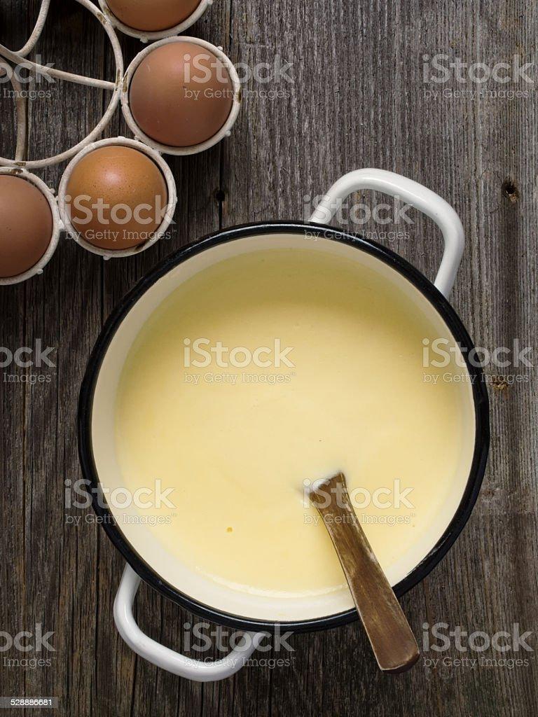 pot of creamy custard sauce stock photo