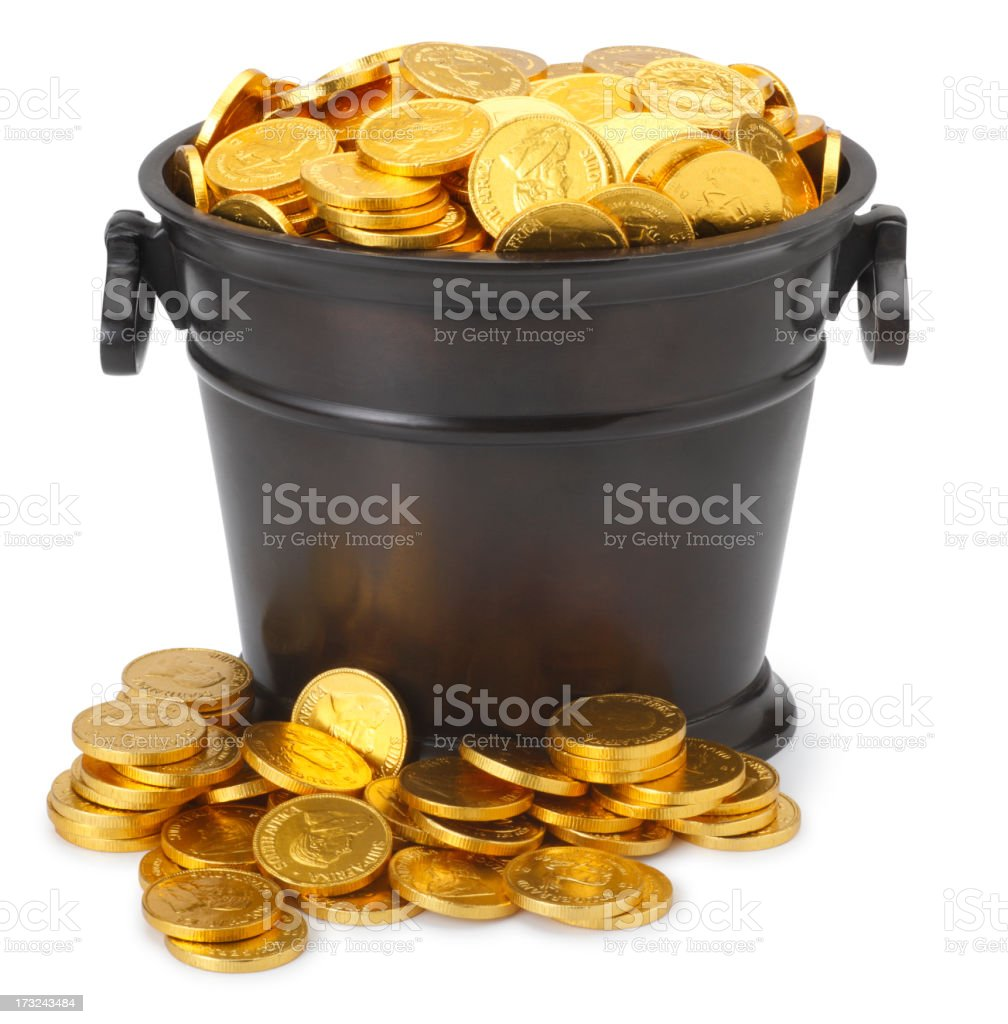 Pot of gold coins isolated on a white background stock photo