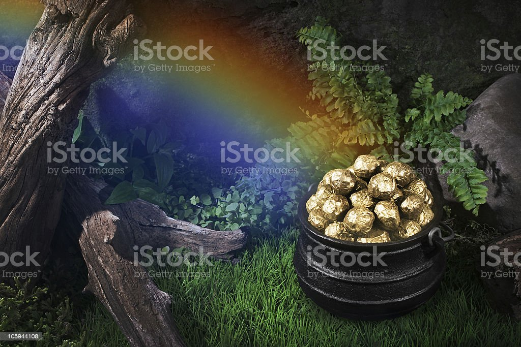 Pot of gold in the wood stock photo