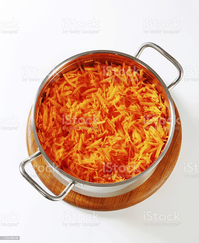 pot of grated carrot stock photo