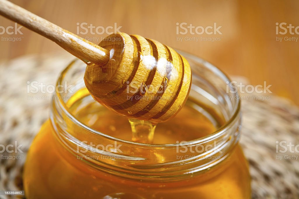 Pot of honey stock photo