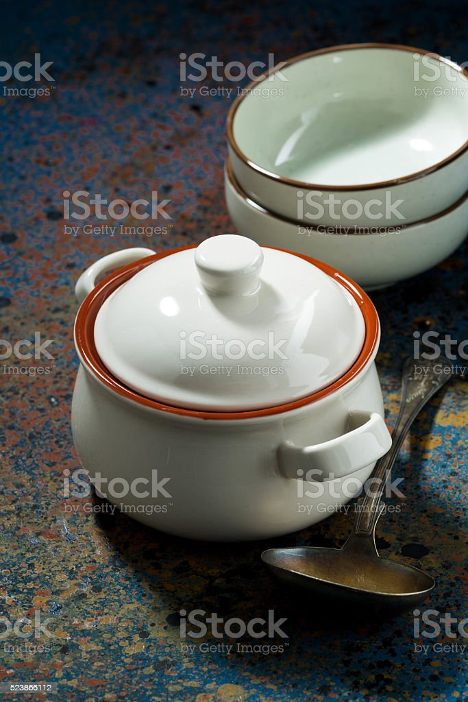 pot of soup on a dark background, top view vertical stock photo