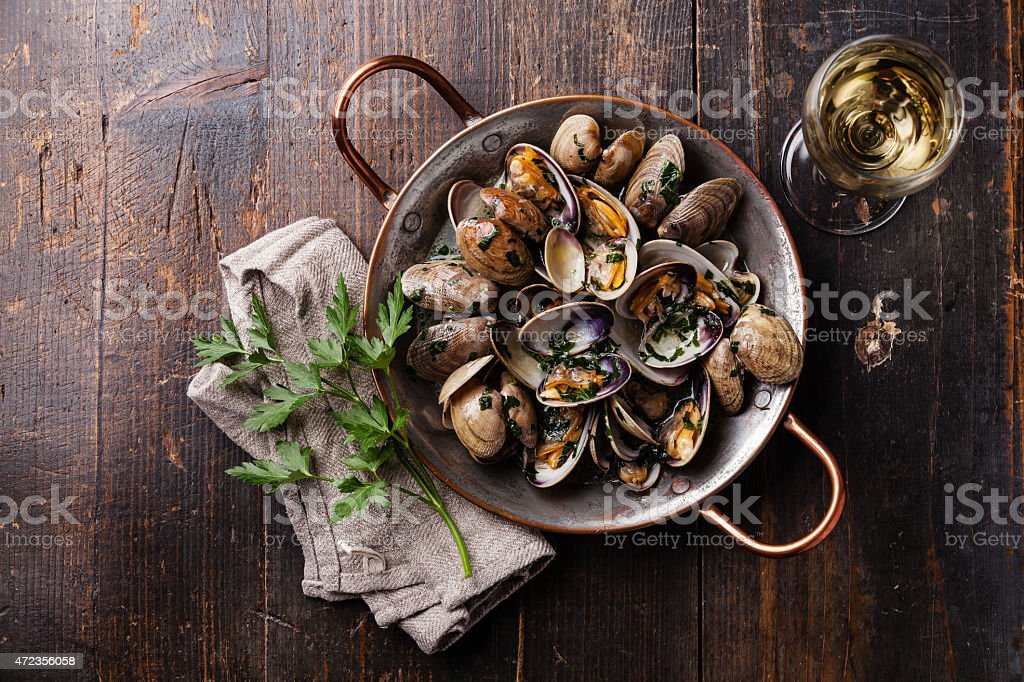 A pot of steamed vongole clams stock photo