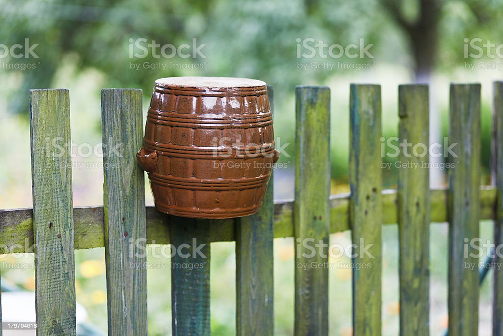 Pot on a fence royalty-free stock photo