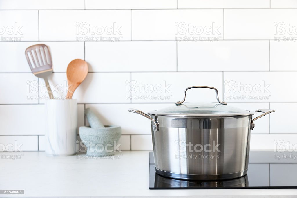 Pot on kitchen induction cooktop stock photo
