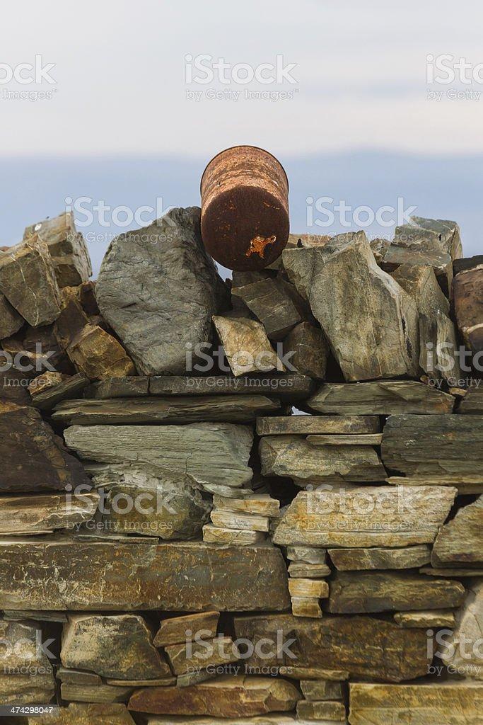 Pot on Stone Wall - Bote en Muro de Piedra royalty-free stock photo