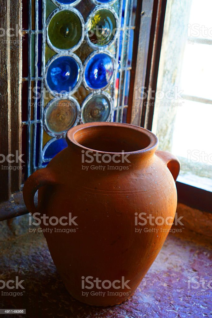 Pot on windowsill stock photo