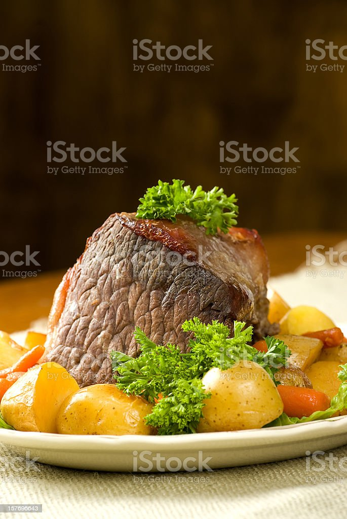 Pot roast dinner with potoatoes and carrots. royalty-free stock photo