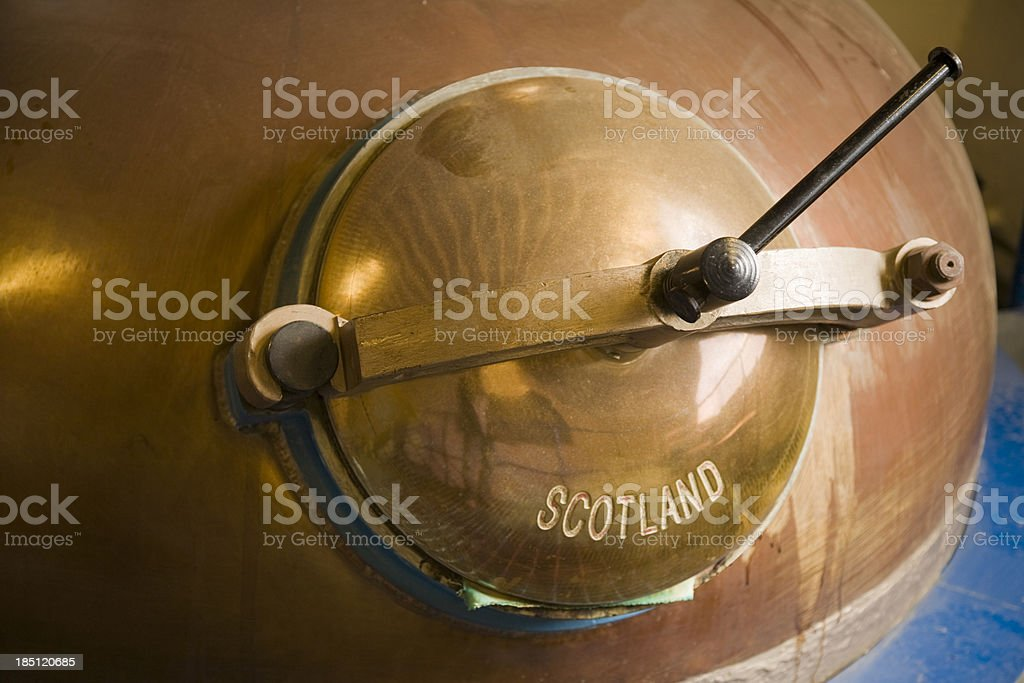 Pot still lid in whiskey distillery stock photo