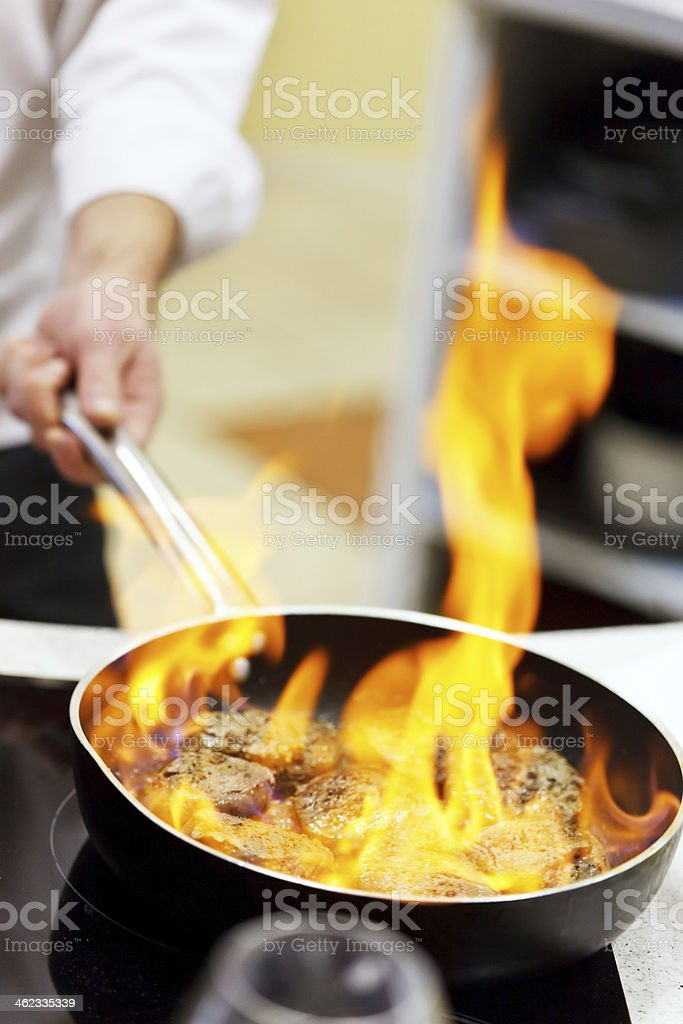 pot with fire stock photo