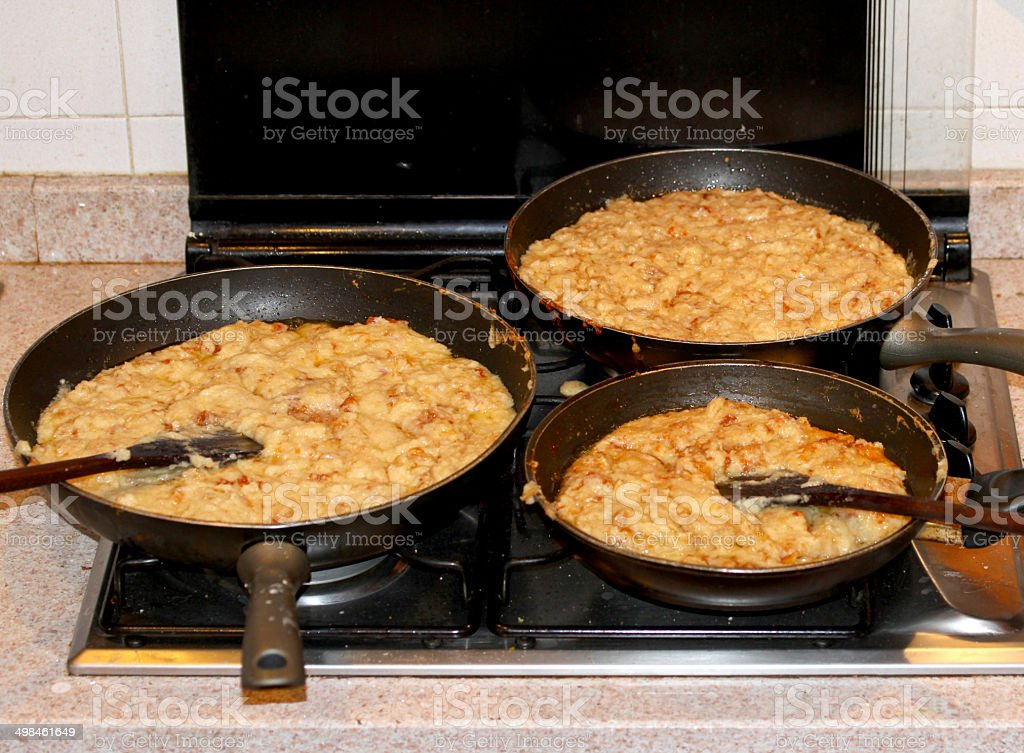 pot with many FRICO, Friulan cuisine dish of Italy stock photo