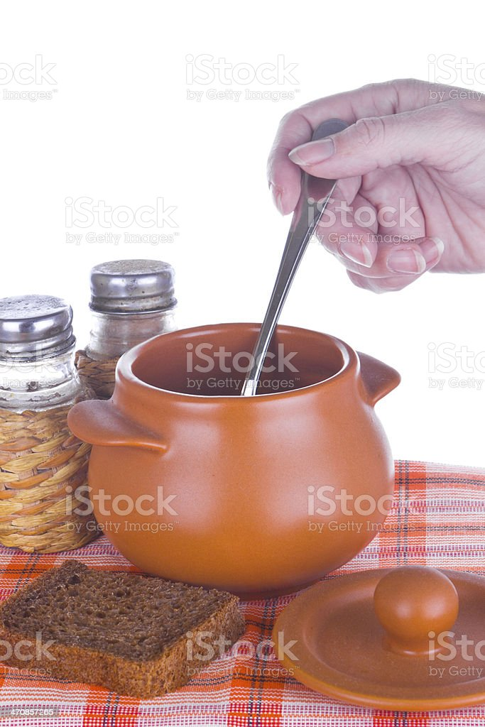 Pot with prepared meal and bread royalty-free stock photo