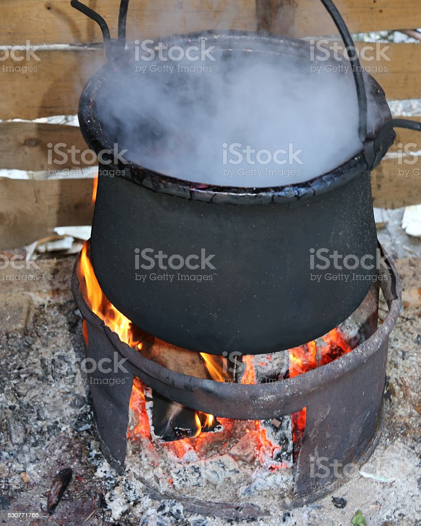 pot with the fire and smoke stock photo